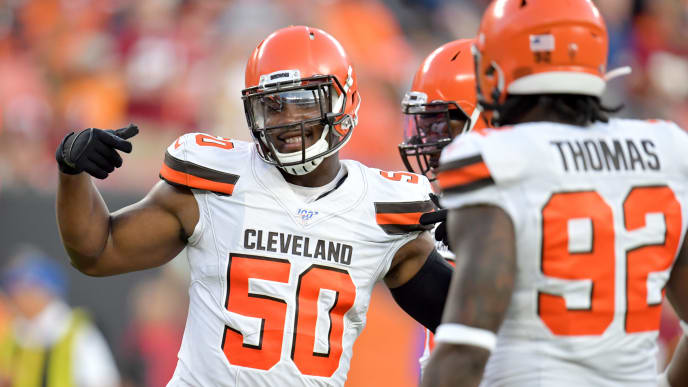 CLEVELAND, OHIO - AUGUST 08: Defensive end Chris Smith #50 of the Cleveland Browns celebrates during the first half of a preseason game against the Washington Redskins at FirstEnergy Stadium on August 08, 2019 in Cleveland, Ohio. (Photo by Jason Miller/Getty Images)