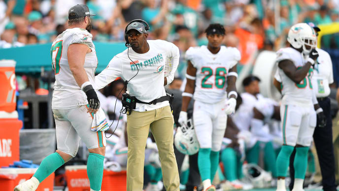 MIAMI, FLORIDA - OCTOBER 13 Head coach Brian Flores of the Miami Dolphins celebrates with Daniel Kilgore #67 during the game against the Washington Redskins in the fourth quarter at Hard Rock Stadium on October 13, 2019 in Miami, Florida. (Photo by Mark Brown/Getty Images) (Photo by Mark Brown/Getty Images)
