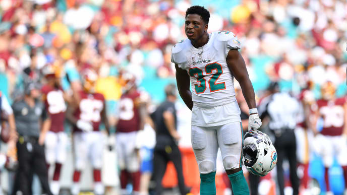 MIAMI, FLORIDA - OCTOBER 13: Kenyan Drake #32 of the Miami Dolphins looks on during a break in the game against the Washington Redskins in the fourth quarter at Hard Rock Stadium on October 13, 2019 in Miami, Florida. (Photo by Mark Brown/Getty Images)