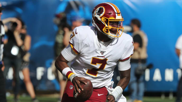 EAST RUTHERFORD, NEW JERSEY - SEPTEMBER 29: Quarterback Dwayne Haskins, Jr. #7 of the Washington Redskins rolls out against the New York Giants in the second half at MetLife Stadium on September 29, 2019 in East Rutherford, New Jersey. The Giants defeated the Redskins 24-3. (Photo by Al Pereira/Getty Images)