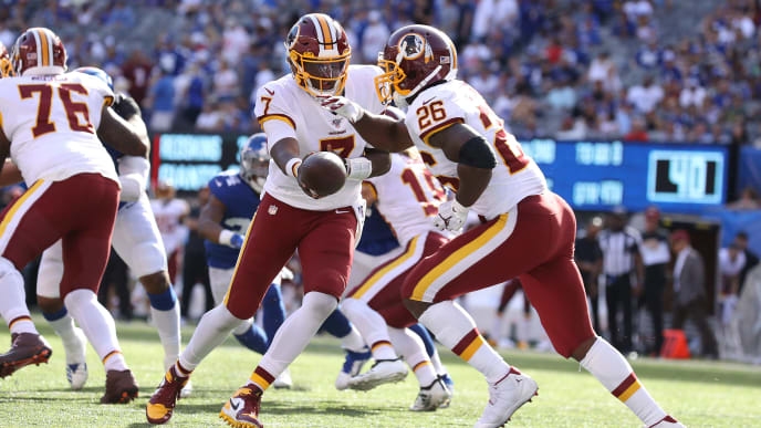 EAST RUTHERFORD, NEW JERSEY - SEPTEMBER 29:  Dwayne Haskins #7 of the Washington Redskins hands off to Adrian Peterson #26 of the Washington Redskins against the New York Giants during their game at MetLife Stadium on September 29, 2019 in East Rutherford, New Jersey. (Photo by Al Bello/Getty Images)