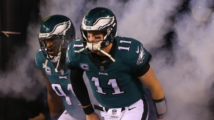 PHILADELPHIA, PA - DECEMBER 03:  Defensive tackle Fletcher Cox #91 and quarterback Carson Wentz #11 of the Philadelphia Eagles run onto the field before taking on the Washington Redskins at Lincoln Financial Field on December 3, 2018 in Philadelphia, Pennsylvania.  (Photo by Mitchell Leff/Getty Images)