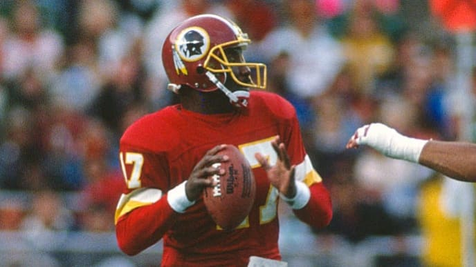 PHILADELPHIA, PA - NOVEMBER 12:  Quarterback Doug Williams #17 of the Washington Redskins drops back to pass against the Philadelphia Eagles during an NFL football game November 12, 1989 at Veterans Stadium in Philadelphia, Pennsylvania. Williams played for the Redskins from 1986-89. (Photo by Focus on Sport/Getty Images)