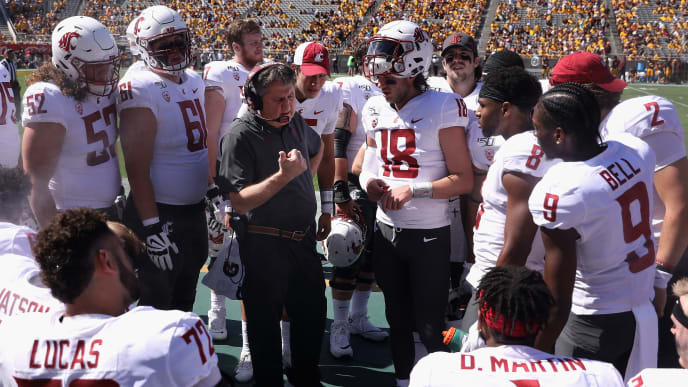 TEMPE, ARIZONA - OCTOBER 12:  Head coach Mike Leach of the Washington State Cougars talks with his team on the sidelines during the first half of the NCAAF game against the Arizona State Sun Devils at Sun Devil Stadium on October 12, 2019 in Tempe, Arizona. (Photo by Christian Petersen/Getty Images)