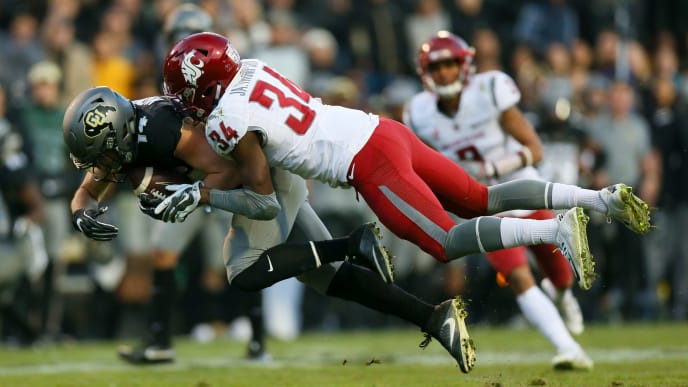 BOULDER, CO - NOVEMBER 19:  Wide receiver Jay MacIntyre #14 of the Colorado Buffaloes is tackled by safety Jalen Thompson #34 of the Washington State Cougars after making a catch during the third quarter at Folsom Field on November 19, 2016 in Boulder, Colorado. Colorado defeated Washington State 38-24. (Photo by Justin Edmonds/Getty Images)