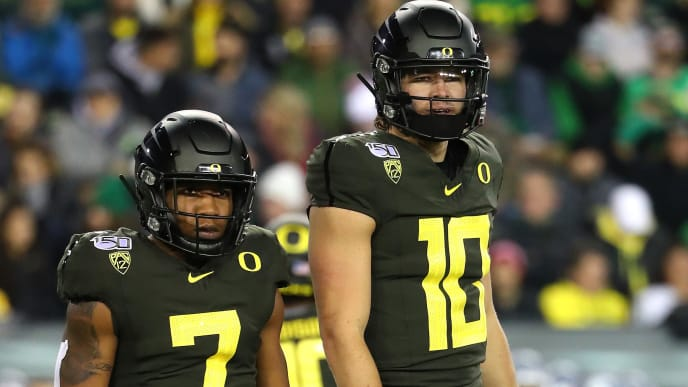EUGENE, OREGON - OCTOBER 26: CJ Verdell #7 of the Oregon Ducks and Justin Herbert #10 of the Oregon Ducks look on in the first quarter against the Washington State Cougars during their game at Autzen Stadium on October 26, 2019 in Eugene, Oregon. (Photo by Abbie Parr/Getty Images)