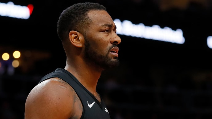 ATLANTA, GEORGIA - DECEMBER 18:  John Wall #2 of the Washington Wizards reacts after he was charged with a foul against the Atlanta Hawks at State Farm Arena on December 18, 2018 in Atlanta, Georgia.  NOTE TO USER: User expressly acknowledges and agrees that, by downloading and or using this photograph, User is consenting to the terms and conditions of the Getty Images License Agreement. (Photo by Kevin C.  Cox/Getty Images)