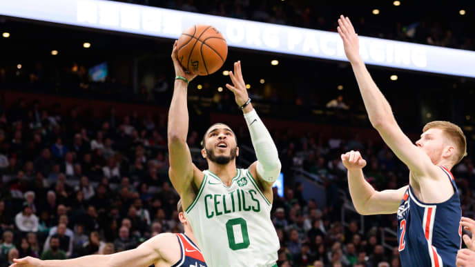 BOSTON, MA - NOVEMBER 13: Jayson Tatum #0 of the Boston Celtics shoots against Davis Bertans #42 of the Washington Wizards in the second half at TD Garden on November 13, 2019 in Boston, Massachusetts. NOTE TO USER: User expressly acknowledges and agrees that, by downloading and or using this photograph, User is consenting to the terms and conditions of the Getty Images License Agreement. (Photo by Kathryn Riley/Getty Images)