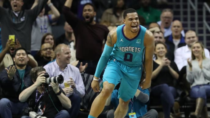 CHARLOTTE, NORTH CAROLINA - FEBRUARY 22: Miles Bridges #0 of the Charlotte Hornets reacts after a play against the Washington Wizards during their game at Spectrum Center on February 22, 2019 in Charlotte, North Carolina. NOTE TO USER: User expressly acknowledges and agrees that, by downloading and or using this photograph, User is consenting to the terms and conditions of the Getty Images License Agreement. (Photo by Streeter Lecka/Getty Images)