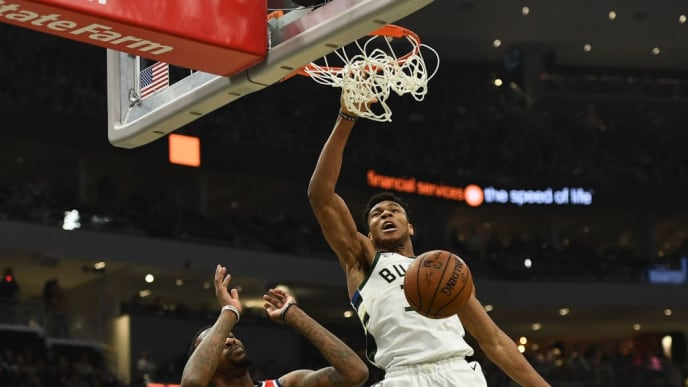 MILWAUKEE, WISCONSIN - FEBRUARY 06:  Giannis Antetokounmpo #34 of the Milwaukee Bucks dunks in front of Jordan McRae #52 of the Washington Wizards during the first half of a game at Fiserv Forum on February 06, 2019 in Milwaukee, Wisconsin.  NOTE TO USER: User expressly acknowledges and agrees that, by downloading and or using this photograph, User is consenting to the terms and conditions of the Getty Images License Agreement. (Photo by Stacy Revere/Getty Images)