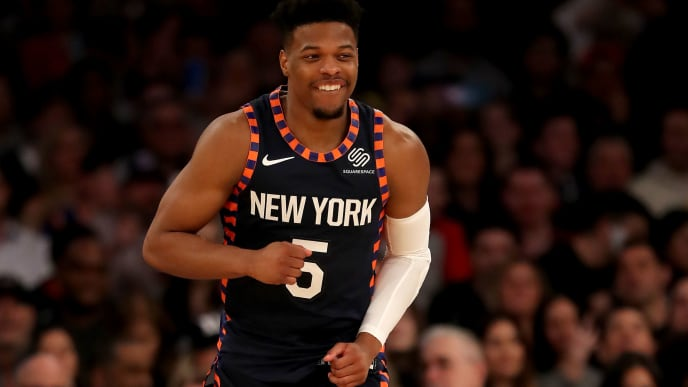 NEW YORK, NEW YORK - APRIL 07:  Dennis Smith Jr. #5 of the New York Knicks celebrates his shot in the first half against the Washington Wizards at Madison Square Garden on April 07, 2019 in New York City. NOTE TO USER: User expressly acknowledges and agrees that, by downloading and or using this photograph, User is consenting to the terms and conditions of the Getty Images License Agreement. (Photo by Elsa/Getty Images)