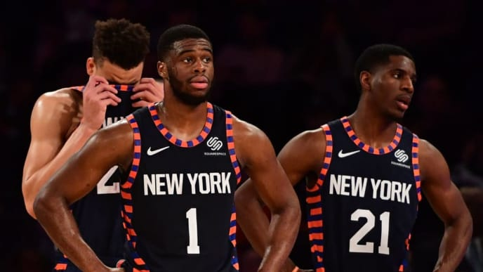 NEW YORK, NEW YORK - DECEMBER 03: Kevin Knox #20, Emmanuel Mudiay #1, and Damyean Dotson #21 of the New York Knicks react during the fourth quarter of the game against Washington Wizards at Madison Square Garden on December 03, 2018 in New York City. NOTE TO USER: User expressly acknowledges and agrees that, by downloading and or using this photograph, User is consenting to the terms and conditions of the Getty Images License Agreement. (Photo by Sarah Stier/Getty Images)