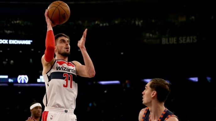 NEW YORK, NEW YORK - APRIL 07:   Tomas Satoransky #31 of the Washington Wizards takes a shot as Mario Hezonja #8 of the New York Knicks defends at Madison Square Garden on April 07, 2019 in New York City. NOTE TO USER: User expressly acknowledges and agrees that, by downloading and or using this photograph, User is consenting to the terms and conditions of the Getty Images License Agreement. (Photo by Elsa/Getty Images)
