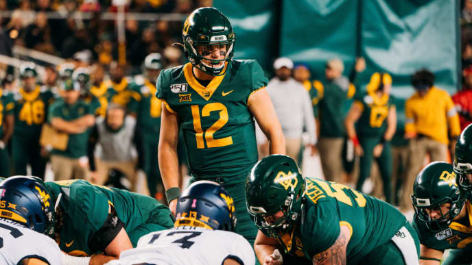 WACO, TX - OCTOBER 31: Quarterback Charlie Brewer #12 of the Baylor Bears lines up at the goal line against the West Viriginia Mountaineers at McLane Stadium  on October 31, 2019 in Waco, Texas. (Photo by Adrian Garcia/Getty Images)