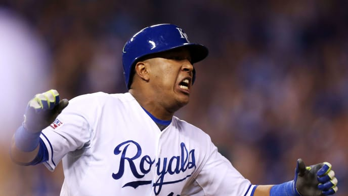 KANSAS CITY, MO - SEPTEMBER 30:  Salvador Perez #13 of the Kansas City Royals reacts after hitting the game winning RBI single in the 12th inning against the Oakland Athletics during the American League Wild Card game at Kauffman Stadium on September 30, 2014 in Kansas City, Missouri.  (Photo by Ed Zurga/Getty Images)