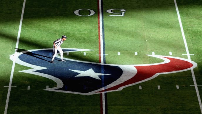 HOUSTON, TX - JANUARY 07:  A referee is seen standing on a Houston Texans logo while the Texans host the Cincinnati Bengals during their 2012 AFC Wild Card Playoff game at Reliant Stadium on January 7, 2012 in Houston, Texas.  (Photo by Thomas B. Shea/Getty Images)
