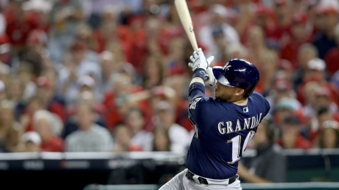 WASHINGTON, DC - OCTOBER 01: Yasmani Grandal #10 of the Milwaukee Brewers hits a two run home run to score Trent Grisham #2 against Max Scherzer #31 of the Washington Nationals during the first inning in the National League Wild Card game at Nationals Park on October 01, 2019 in Washington, DC. (Photo by Rob Carr/Getty Images)