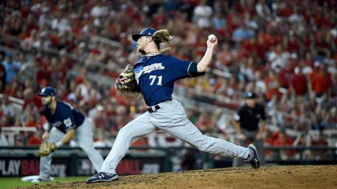 WASHINGTON, DC - OCTOBER 01: Josh Hader #71 of the Milwaukee Brewers throws a pitch against the Washington Nationals during the eighth inning in the National League Wild Card game at Nationals Park on October 01, 2019 in Washington, DC. (Photo by Will Newton/Getty Images)