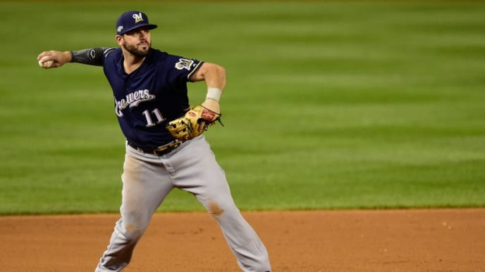 WASHINGTON, DC - OCTOBER 01: Mike Moustakas #11 of the Milwaukee Brewers makes a throw to first base in the fifth inning of the National League Wild Card game against the Washington Nationals at Nationals Park on October 1, 2019 in Washington, DC. (Photo by Patrick McDermott/Getty Images)