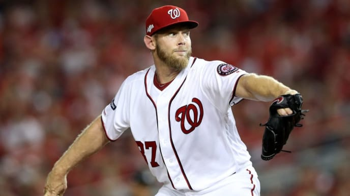 WASHINGTON, DC - OCTOBER 01: Stephen Strasburg #37 of the Washington Nationals throws a pitch against the Milwaukee Brewers during the sixth inning in the National League Wild Card game at Nationals Park on October 01, 2019 in Washington, DC. (Photo by Rob Carr/Getty Images)
