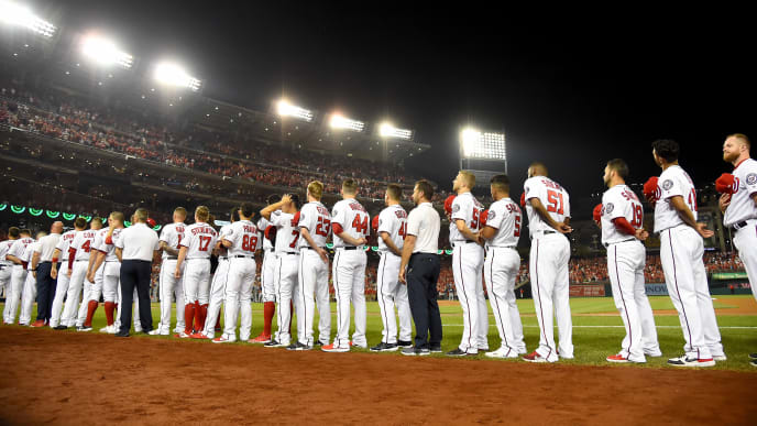 WASHINGTON, DC - OCTOBER 01: The Washington Nationals stand for the national anthem prior to the National League Wild Card game against the Milwaukee Brewers at Nationals Park on October 01, 2019 in Washington, DC. (Photo by Will Newton/Getty Images)