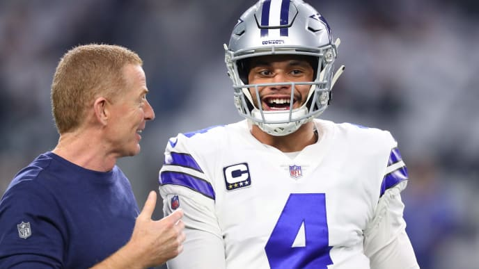ARLINGTON, TEXAS - JANUARY 05: Head coach Jason Garrett  visits with Dak Prescott #4 of the Dallas Cowboys before the game against the Seattle Seahawks during the Wild Card Round at AT&T Stadium on January 05, 2019 in Arlington, Texas. (Photo by Tom Pennington/Getty Images)