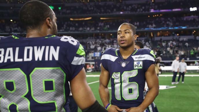ARLINGTON, TEXAS - JANUARY 05:   Tyler Lockett #16 of the Seattle Seahawks talks with Doug Baldwin #89 after a 24-22 loss against the Dallas Cowboys in the Wild Card Round at AT&T Stadium on January 05, 2019 in Arlington, Texas. (Photo by Ronald Martinez/Getty Images)