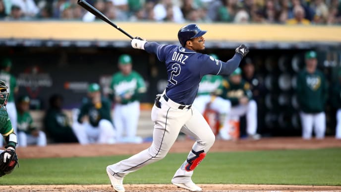 OAKLAND, CALIFORNIA - OCTOBER 02:  Yandy Diaz #2 of the Tampa Bay Rays hits a solo home run off Sean Manaea #55 of the Oakland Athletics	in the third inning of the American League Wild Card Game at RingCentral Coliseum on October 02, 2019 in Oakland, California. (Photo by Ezra Shaw/Getty Images)