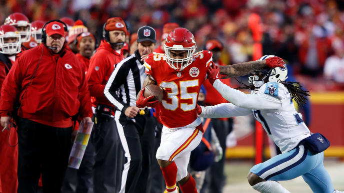 KANSAS CITY, MO - JANUARY 06:  Running back Charcandrick West #35 of the Kansas City Chiefs is pushed out-of-bounds by strong safety Johnathan Cyprien #37 of the Tennessee Titans during the game at Arrowhead Stadium on January 6, 2018 in Kansas City, Missouri.  (Photo by Jamie Squire/Getty Images)