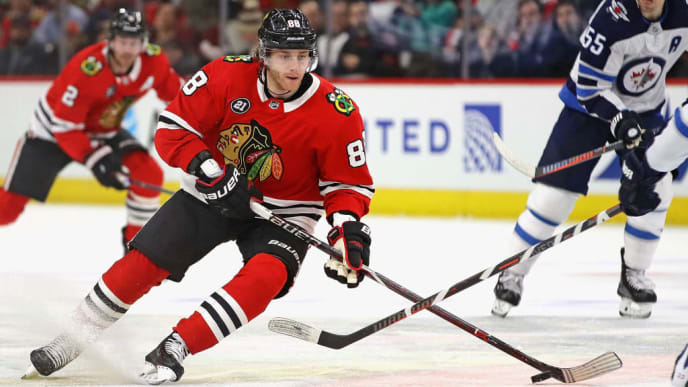 CHICAGO, ILLINOIS - APRIL 01: Patrick Kane #88 of the Chicago Blackhawks tries to advance against the Winnipeg Jets at the United Center on April 01, 2019 in Chicago, Illinois. (Photo by Jonathan Daniel/Getty Images)