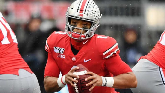 COLUMBUS, OH - OCTOBER 26:  Quarterback Justin Fields #1 of the Ohio State Buckeyes runs with the ball against the Wisconsin Badgers at Ohio Stadium on October 26, 2019 in Columbus, Ohio.  (Photo by Jamie Sabau/Getty Images)
