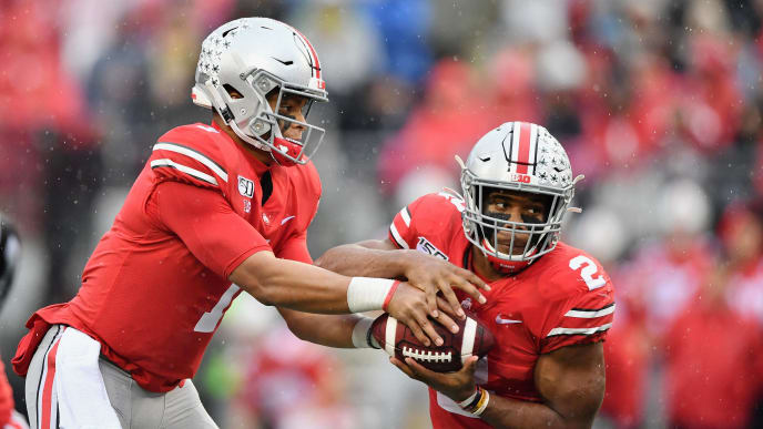 COLUMBUS, OH - OCTOBER 26:  J.K. Dobbins #2 of the Ohio State Buckeyes takes a handoff from quarterback Justin Fields #1 of the Ohio State Buckeyes against the Wisconsin Badgers at Ohio Stadium on October 26, 2019 in Columbus, Ohio.  (Photo by Jamie Sabau/Getty Images)