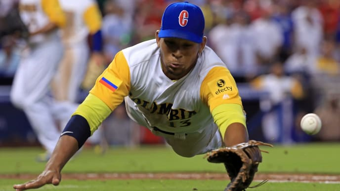 MIAMI, FL - MARCH 12: Reynaldo Rodriguez #6 of the Colombia dives for a foul ball in the ninth inning during a Pool C game of the 2017 World Baseball Classic against the Dominican Republic at Miami Marlins Stadium on March 12, 2017 in Miami, Florida.  (Photo by Mike Ehrmann/Getty Images)
