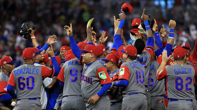 MIAMI, FL - MARCH 12:  The Dominican Republic reacts to winning a Pool C game of the 2017 World Baseball Classic against Colombia at Miami Marlins Stadium on March 12, 2017 in Miami, Florida.  (Photo by Mike Ehrmann/Getty Images)