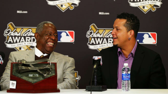 ST LOUIS, MO - OCTOBER 27:  (L-R) Retired American professional baseball player Hank Aaron and 2013 honouree Miguel Cabrera of the Detroit Tigers speak during the 2013 Hank Aaron Award press conference prior Game Four of the 2013 World Series between the Boston Red Sox and the St. Louis Cardinals at Busch Stadium on October 27, 2013 in St Louis, Missouri. Paul Goldschmidt of the Arizona Diamondbacks was also honered with the award.  (Photo by Elsa/Getty Images)