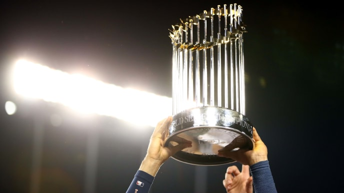 LOS ANGELES, CA - NOVEMBER 01:  Carlos Correa #1 of the Houston Astros holds the Commissioner's Trophy after defeating the Los Angeles Dodgers 5-1 in game seven to win the 2017 World Series at Dodger Stadium on November 1, 2017 in Los Angeles, California.  (Photo by Ezra Shaw/Getty Images)