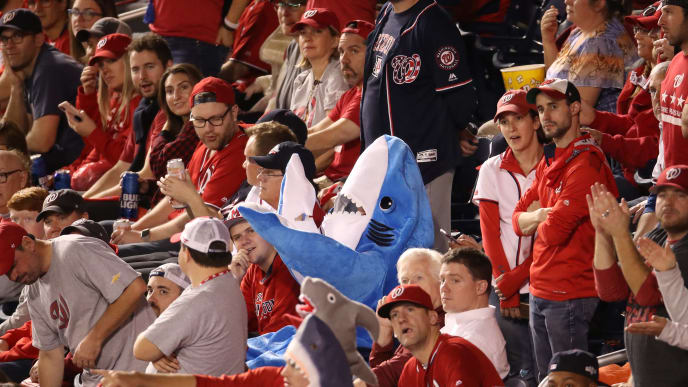 WASHINGTON, DC - OCTOBER 27:  A fan in a shark costume cheers in Game Five of the 2019 World Series between the Houston Astros and the Washington Nationals at Nationals Park on October 27, 2019 in Washington, DC. (Photo by Win McNamee/Getty Images)