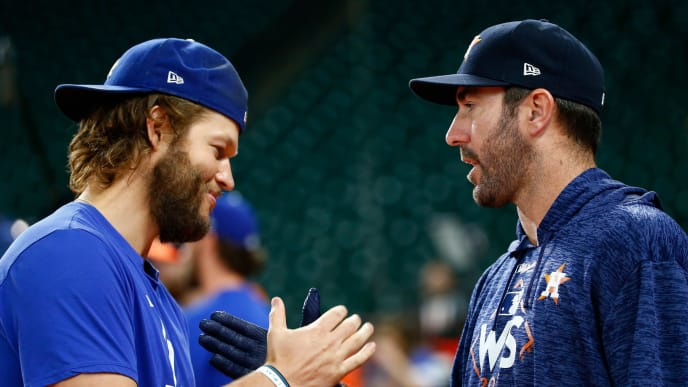 HOUSTON, TX - OCTOBER 27:  Clayton Kershaw #22 of the Los Angeles Dodgers shakes hands with Justin Verlander #35 of the Houston Astros before game three of the 2017 World Series at Minute Maid Park on October 27, 2017 in Houston, Texas.  (Photo by Jamie Squire/Getty Images)