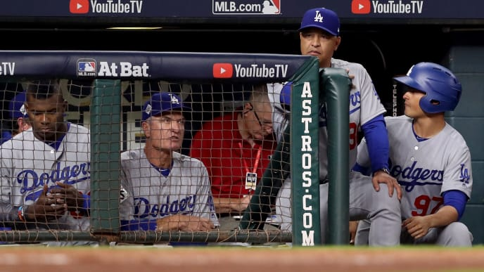 HOUSTON, TX - OCTOBER 29: Manager Dave Roberts #30 of the Los Angeles Dodgers looks on from the dugout against the Houston Astros in game five of the 2017 World Series at Minute Maid Park on October 29, 2017 in Houston, Texas.  (Photo by Christian Petersen/Getty Images)