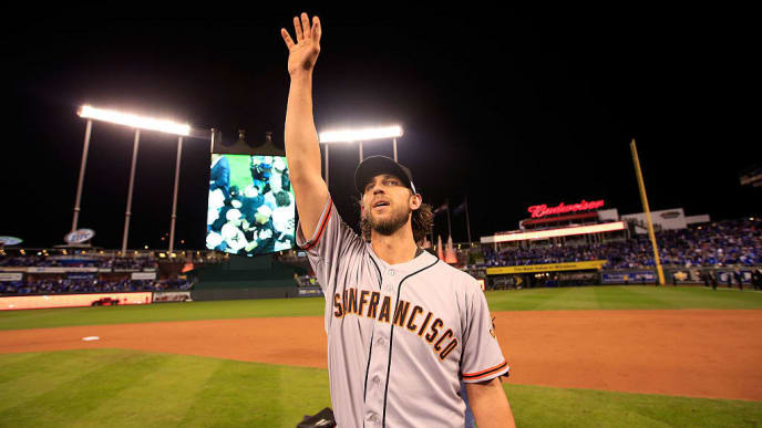 KANSAS CITY, MO - OCTOBER 29: Madison Bumgarner #40 of the San Francisco Giants acknowledges the crowd after defeating the Kansas City Royals to win Game Seven of the 2014 World Series by a score of 3-2 at Kauffman Stadium on October 29, 2014 in Kansas City, Missouri.  (Photo by Jamie Squire/Getty Images)