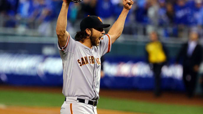 KANSAS CITY, MO - OCTOBER 29:  Madison Bumgarner #40 of the San Francisco Giants celebrates after defeating the Kansas City Royals to win Game Seven of the 2014 World Series by a score of 3-2 at Kauffman Stadium on October 29, 2014 in Kansas City, Missouri.  (Photo by Elsa/Getty Images)