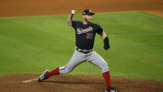 HOUSTON, TEXAS - OCTOBER 29:  Stephen Strasburg #37 of the Washington Nationals delivers the pitch against the Houston Astros during the ninth inning in Game Six of the 2019 World Series at Minute Maid Park on October 29, 2019 in Houston, Texas. (Photo by Bob Levey/Getty Images)