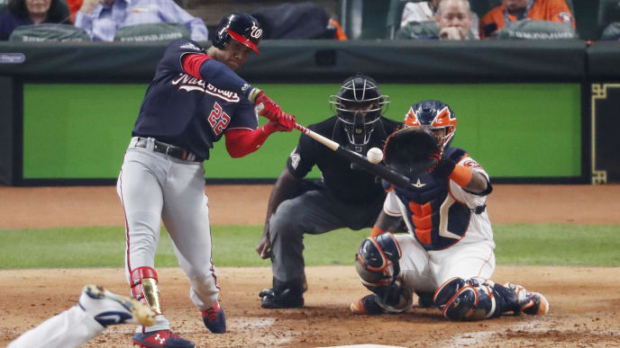 HOUSTON, TEXAS - OCTOBER 22:  Juan Soto #22 of the Washington Nationals hits a solo home run against the Houston Astros during the fourth inning in Game One of the 2019 World Series at Minute Maid Park on October 22, 2019 in Houston, Texas. (Photo by Tim Warner/Getty Images)