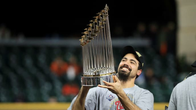 Anthony Rendon holding World Series trophy