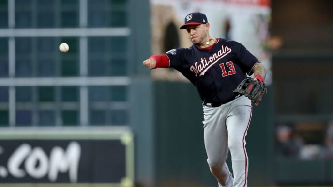 HOUSTON, TEXAS - OCTOBER 30:  Asdrubal Cabrera #13 of the Washington Nationals throws out Alex Bregman (not pictured) of the Houston Astros during the seventh inning in Game Seven of the 2019 World Series at Minute Maid Park on October 30, 2019 in Houston, Texas. (Photo by Elsa/Getty Images)