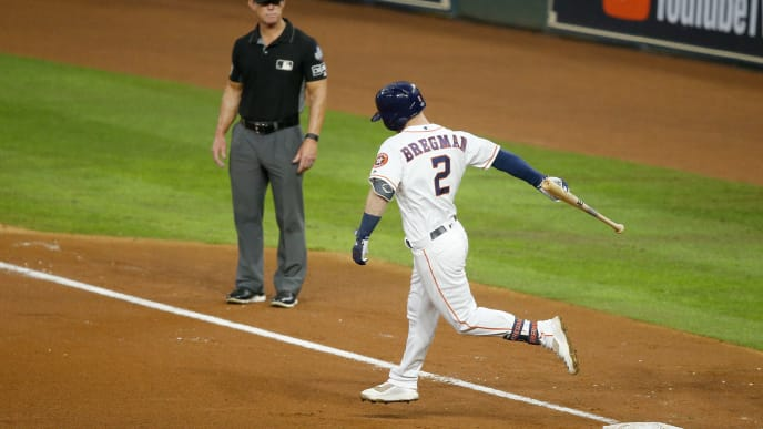 HOUSTON, TEXAS - OCTOBER 29:  Alex Bregman #2 of the Houston Astros carries his bat to first base after hitting a solo home run against the Washington Nationals during the first inning in Game Six of the 2019 World Series at Minute Maid Park on October 29, 2019 in Houston, Texas. (Photo by Bob Levey/Getty Images)