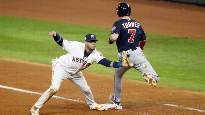 HOUSTON, TEXAS - OCTOBER 29:  Trea Turner #7 of the Washington Nationals is called out on runner interference for colliding with Yuli Gurriel #10 of the Houston Astros during the seventh inning in Game Six of the 2019 World Series at Minute Maid Park on October 29, 2019 in Houston, Texas. (Photo by Bob Levey/Getty Images)