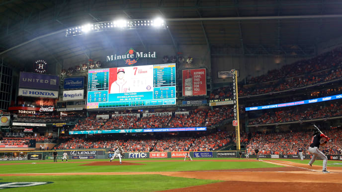 HOUSTON, TEXAS - OCTOBER 22:  Gerrit Cole #45 of the Houston Astros delivers the first pitch of the game to Trea Turner #7 of the Washington Nationals during the first inning in Game One of the 2019 World Series at Minute Maid Park on October 22, 2019 in Houston, Texas. (Photo by Mike Ehrmann/Getty Images)