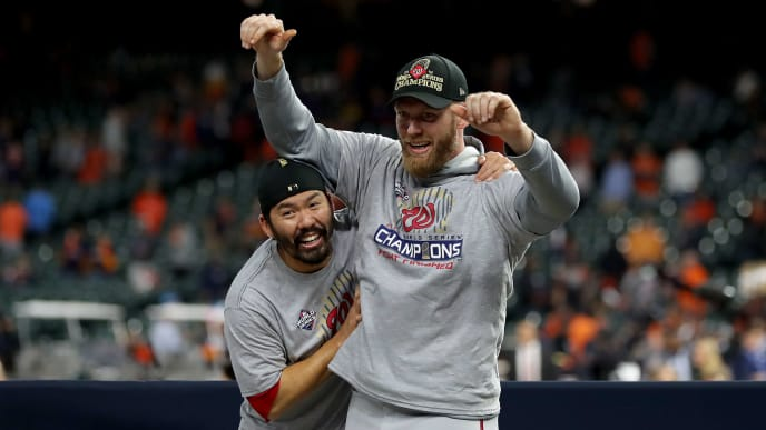 HOUSTON, TEXAS - OCTOBER 30:  Kurt Suzuki #28 and Stephen Strasburg #37 of the Washington Nationals celebrate after defeating the Houston Astros 6-2 in Game Seven to win the 2019 World Series in Game Seven of the 2019 World Series at Minute Maid Park on October 30, 2019 in Houston, Texas. (Photo by Elsa/Getty Images)