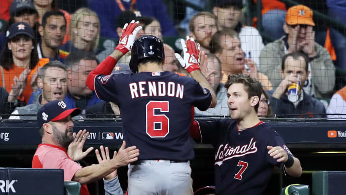 Anthony Rendon celebrates scoring a run in World Series Game 7